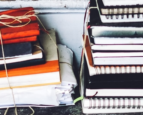 A jumbled pile of notebooks